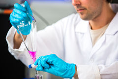 Young male researcher carrying out scientific research in a lab Royalty Free Stock Photo