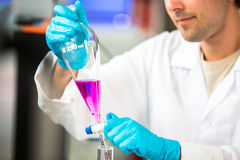 Young male researcher carrying out scientific research in a lab Stock Photo
