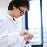 Young, male researcher/chemistry student Royalty Free Stock Photos