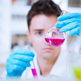 Young male researcher in a lab Royalty Free Stock Images
