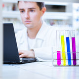 Young male researcher in a lab Stock Image