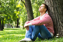 Young male resting in the park Stock Photo