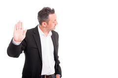 Young male rising up one hand. And doing stop or denial gesture on white background with advertising area Stock Images