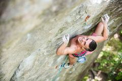 Young male rock climber on challenging route Royalty Free Stock Photos