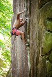 Young male rock climber on challenging route Stock Photo