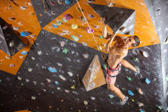 Young male rock climber in indoor climbing gym Royalty Free Stock Photography