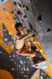 Young male rock climber in indoor climbing gym Royalty Free Stock Photo