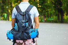 Young male roller skater with roller backpack - shoot from behin Stock Photos