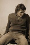 Young male in romantic sweater sepia Royalty Free Stock Photo