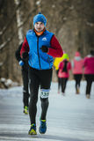Young male runner dressed for winter runs Royalty Free Stock Photo