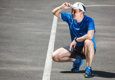 Young male runner getting ready. To start Royalty Free Stock Photos