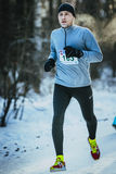 Young male runner running in a winter Park Royalty Free Stock Photos