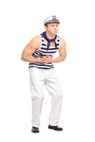 Young male sailor feeling stomach ache stock photo