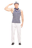 Young male sailor standing straight and saluting. Full length portrait of a young male sailor standing straight and saluting towards the camera isolated on white Royalty Free Stock Photography