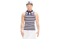 Young male sailor standing straight and smiling. Isolated on white background Royalty Free Stock Photo