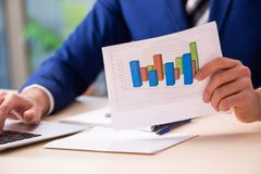 Young male sales analyst in growth concept. The young male sales analyst in growth concept royalty free stock photography