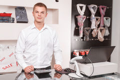 Young male sales assistant at work Royalty Free Stock Images