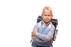 Young male schoolchild with satchel is angry. Beautiful schoolboy is  looking angry on his first schoolday. Isolated on white Royalty Free Stock Photo