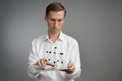 Young male scientist working with a model of the atom. Royalty Free Stock Photography