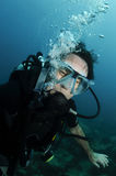 Young male scuba diver portrait. In clear water Stock Photography