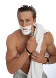 Young male shaving isolated Stock Photography