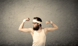 Young male showing muscles Royalty Free Stock Images