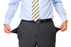 Young male shows empty pockets, isolated. Young male shows empty pockets in his trousers, business concept, studio shoot isolated on white background Royalty Free Stock Images