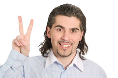 Young male shows victory sign isolated white Royalty Free Stock Photo