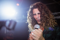Young male singer performing at nightclub. During music festival Royalty Free Stock Photo