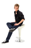 Young male sitting on chair Stock Photography
