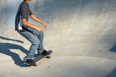 Young Male Skateboarder in the pit. At a skate park royalty free stock photos