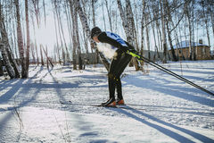 Young male skier of classic style in winter woods on sports race, vapor when breathing Royalty Free Stock Photo