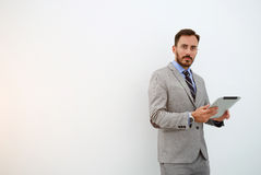 Young male skilled manager is using portable digital tablet before conference royalty free stock photo