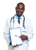 Young male smiling doctor showing clipboard with copy space for. Text on white Royalty Free Stock Image
