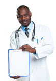 Young male smiling doctor showing clipboard with copy space for. Text on white background Royalty Free Stock Photos