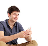 Young male smiling using mobile phone Stock Image