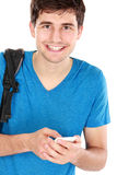 Young male smiling using mobile phone Royalty Free Stock Images