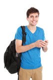 Young male smiling using mobile phone Royalty Free Stock Image