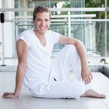 Young male smiling whilst looking at camera Royalty Free Stock Photography