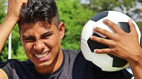 Young Male Soccer Player Under Stress. A young male hispanic teen Stock Photos