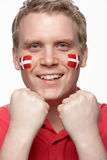 Young Male Sports Fan With Danish Flag On Face. Young Male Sports Fan With Danish Flag Painted On Face Royalty Free Stock Images
