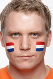 Young Male Sports Fan With Dutch Flag Painted On F Royalty Free Stock Photos