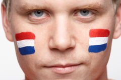 Young Male Sports Fan With Dutch Flag Painted On F Royalty Free Stock Photography