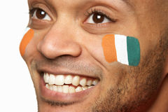 Young Male Sports Fan With Ivory Coast Flag Painte Royalty Free Stock Photography