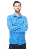 Young male standing with arms crossed Stock Image