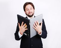 Young male standing with laptop as a book Stock Photos