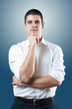 Businessman in shirt. Young male standing and looking at camera Royalty Free Stock Images