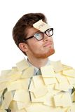 Young male with a sticky note on his face, covered with yellow stickers Stock Image