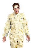 Young male with a sticky note on his face, covered with yellow sticky notes Stock Photo