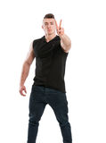 Young male stud showing peace sign Royalty Free Stock Photography